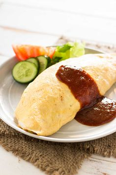 Omurice, Omelette Rice, is a popular and tasty Japanese dish made from ketchup flavoured chicken fried rice wrapped in an egg omelette.