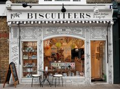 Cafes and Boutiques The Biscuiteers boutique in Notting Hill now has some beautiful seating outside.nice for when the sun is shining!The Biscuiteers boutique in Notting Hill now has some beautiful seating outside.nice for when the sun is shining! Boutiques, Oh The Places You'll Go, Places To Visit, Virée Shopping, London Shopping, Café Bar, Cafe Shop, Shop Fronts, London Travel