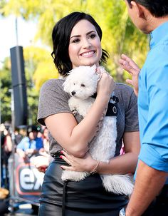 Demi Lovato snuggled up to her dog Buddy on the Hollywood set of Extra on March 3.