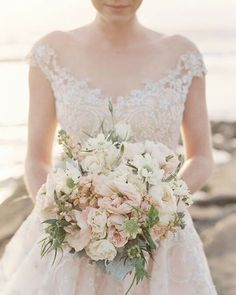 Our #Wtoo Audrey by the sea. Beautiful #bouquet by @blushbotanicals and photo by @morganlamkin. #flowerfriday #watters #weddingdress #blush #weddinginspiration