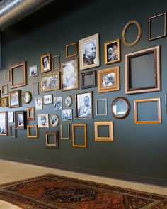 We love the mix of frames on this gallery wall - some empty, some full. The wall gorgeous color has us swooning too.