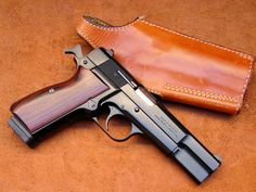 T2: I've never been fond of the Browning Hi Power, but this is an exceptionally good looking example.