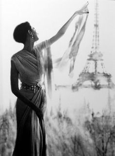 Model Barbara Mullen by the Eiffel Tower, Paris, 1950s. Photo by Lillian Bassman.