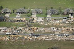 A row of lightly damaged houses, top, face destroyed homes in a Vilonia, Ark., neighbourhood Monday, April 28, 2014 after a tornado struck the town late Sunday night