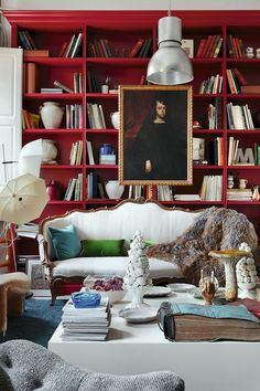 Room of the Day ~ original red library with white furnishings, curvy sofa and art ~ María Lladó design 9.2.2013