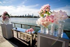 Pink flowers adorn the ceremony signing table with an amazing view of the city. Styled by Styled by Coco. Flowers by The Bouquets of Ascha Jolie. #foodanddesire #styledbycoco #thebouquetsofaschajolie www.foodanddesire.com.au
