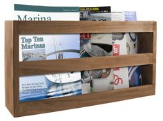 Features:  -Material: 100% Solid teak.  -Mounting hardware not included.  -Wide enough for charts and navigation books.  Material: -Wood.  Finish: -Brown. Dimensions:  Overall Height - Top to Bottom: