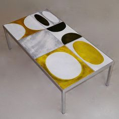 Rare coffee table, glazed lava table tops wonderfully decorated with abstract and geometric patterns in shades of warm yellow, grey and white crackle, and warm