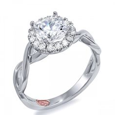 Designer Engagement Rings from DemarcoJewelry.com Available in White or Yellow Gold 18KT and Platinum. 0.21RD Capture her grace and endless beauty with this confident yet elegant design. We have also incorporated a unique pink diamond with every single one of our rings, symbolizing that hidden, unspoken emotion and feeling one carries in their heart about their significant other. This is not just another ring, this is a heirloom piece of jewelry.