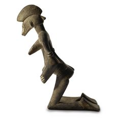 A SUPERB, EXTREMELY RARE AND IMPORTANT SENUFO KNEELING FEMALE FIGURE, Ivory Coast | lot | Sotheby's