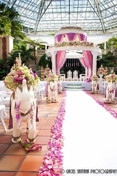 South Asian Wedding Inspiration —How adorable are the little elephants along the aisle!? #WeddingsThatWow #DesiWedding #IndianWedding