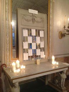 Mirrored table plan hanging on ribbons. Design by The Lake Como Wedding Planner #lakecomo #wedding #weddingplanner