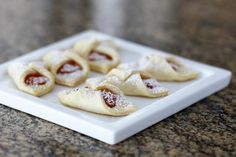These simple butter cookies are made with a pastry-like cream cheese dough. The jam filling and a light dusting of confectioners' sugar are the only sweeteners.