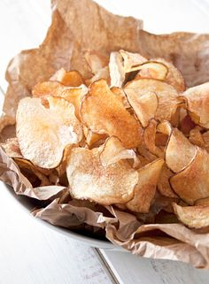 These foolproof homemade potato chips are crispy & crunchy, slightly salted and served hot from the fryer - perfect for parties, game days or get togethers!
