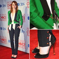 Something about this outfit intrigues me, but I'm not sure what. green/black military-ish jacket, tight pants, buttons at the ankle, high heels