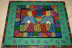 Unique Mola reverse applique created by a Kuna Indian, Panama, and framed in a hand painted signed frame.  asmatcollection on ebay and Bonanza.com cheetahdmr@aol.com