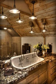 Cabin-friendly old fashioned large sink with the stone countertops