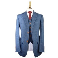 "Our very famous tweed suit. Our blue herringbone plaid tweed suit is the ""creme de la creme"" of our collection. An eye-catching 3 piece suitable for weddings, special occasions and everyday smart wear for the modern gentleman. You will love the way you look and so will everyone who see you in it. Guaranteed to turn heads."