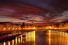 Red Sunset in Italy. Luminara di San Ranieri  in Piza.
