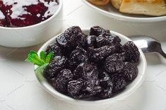 Prunes on small plate and plum jam. by Mellisandra on @creativemarket