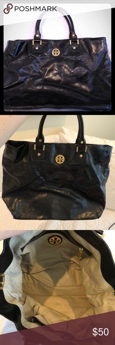 Tory Burch medium black leather totes Lightly used black leather Tory Burch magnetic close tote. Great work a work bag (definitely fits laptop). Excellent condition/no scratches. Tory Burch Bags Totes