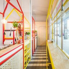 Zapiekanka restaurant by MFRMGR The entire spatial idea relates to the market booths where virtually everything was sold in Warsaw in the 90s, The small space features five such booths with different dimensions. Each stall is dedicated for a particular function in the process of preparing food.  powder-coated steel profiles-zinc-coated stall-softwood plywood coated with clear varnish-