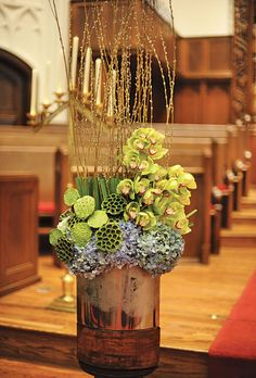 Modern Blue and Green Ceremony Decor. Modern floral arrangements decorated the altar.