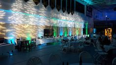 "Marshall School Spring fundraiser. ""Night along the North Shore"" Up lighting in blue and greens, with tree gobos. www.dulutheventlighting.com © 2016 Duluth Event Lighting. All Rights Reserved."