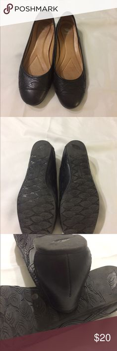 8 1/2 M Nuture black flats Leather lined interior with cushioned heel. Intricate design on the outside and non slip on bottom. Worn a few times. Nurture Shoes Flats & Loafers