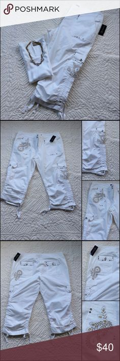 """INC International Fashionable Capris W/ Bonus Top Gold embroidered accents. Top off with great clear rhinestones ( large at waist & pockets) and small scatter thru out the pants. Pants are a lightweight white. The leg hem line is like a elastic bungee that can adjust up & tie. The waist is 39 1/2 inches, inseam is 20"""" without being bunch up with the ties.  97% Cotton 3% Spandex  Mach. wash/dry low. The top is by Liz Claiborne & body is a rib style material. Key hole in the back with button…"""