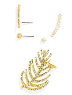 Olivia Palermo Guest Bartender Collection. Pavé crystal transforms a delicate branch into something strikingly elegant, while star-like crystals shimmer in this set made for mixing and matching an asymmetrical look. Set consists of five pieces including two delicate studs, two petite ear crawlers and one statement ear crawler.