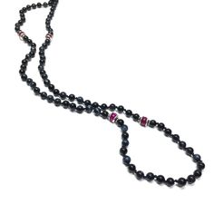 """Blue Tigers Eye & Ruby Beaded Necklace $280.00 This handstrung blue tigers and ruby beaded necklace is detailed with sterling silver spacers. Necklace offers a classic-chic look for the wearer."""