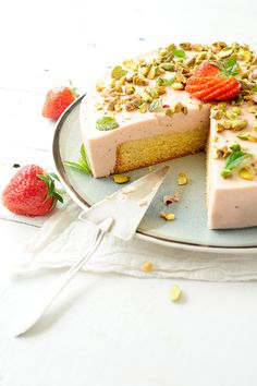sponge cake with strawberry bavarian cream, strawberry coulis and pistachios