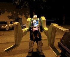 My highest priority was keeping my little girl safe, so the costume was designed for mobility and quick exit in case of emergency. The boots are basically cardboard slippers that could pop right off. With a shrug of my shoulders, I could pop the arms right off. What you can't see from the video is that there are no bottoms on the robot arms, so my human arms were completely free and unimpeded. I could leave the claws hanging idle from the shoulder joints while I could address any of my…