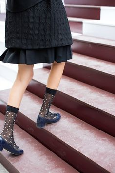 Cute black dress coat | black sheer polka for socks | blue velvet low-heel shoes
