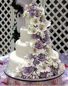 Wedding cake with purple flowers