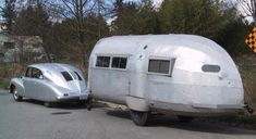 A 1947 Tatra T87 towing a 1935 Hawley Bowlus Road Chief trailer. There's so much wonderful streamlining going on here that it's surprising that they don't just float away.