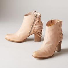 """SOCIETY BOOTS--Step out in our statement-making boots with elegantly draped, leather accents, double zippers and stacked heels. Leather. Italy. Exclusive. Euro whole sizes 36 to 41. 36 (US 5.5), 37 (US 6.5), 38 (US 7.5), 39 (US 8.5), 40 (US 9.5), 41 (US 10). 3"""" heel."""
