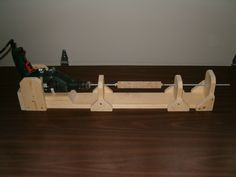 """Here's a couple of jigs I built:  Handle turning jig made out of about 6' of 1x4 and 2 dryer clamps. I glue up cork rings on a 1/4"""" threaded..."""
