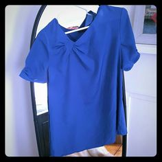 Royal blue asymmetrical blouse Royal blue blouse with asymmetrical neckline. Sleeves are 2 inches longer than a normal short sleeve. Great for work! The Limited Tops Blouses