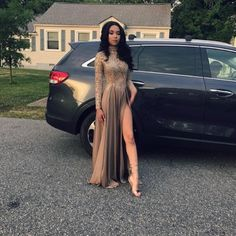 Gold prom dress with gold shoes.