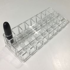 """Acrylic 24 Lipstick Riser Holder • used but in almost new condition! Does not come with lipstick in picture. • fits 24 lipsticks - 8-3/4"""" x 3-1/2"""" x 1-7/8"""" h   • price firm - will not respond to any offer requests     • discounts only on bundles of 3 or more -- please use bundle feature on pm  • no trades - will not respond to any trade requests  • no outside pm sales - no mercari / paypal / etc. Container Store Makeup Lipstick"""