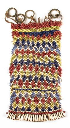 Africa | Cache sexe / apron from Cameroon | Glass beads, cowrie shells, brass rings, natural fiber