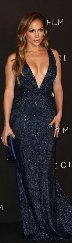 Who made  Jennifer Lopez's blue gown that she wore in Los Angeles on November 1, 2014