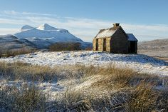A tiny house in Elphin, Assynt, Scotland. Behind the rickety old house lies Cul Mor.