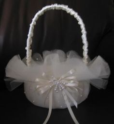 Layers of tulle make for a beautiful flower girl basket accented with pearls and a satin bow Wedding Crafts, Diy Wedding, Wedding Decorations, Diy Flowers, Wedding Flowers, Tulle Flowers, Flower Girl Basket, Pearl Flower, Wedding Accessories
