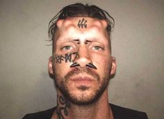 Fancy - '666' tattoo, horn implants and nose piercings...is this the scariest ever mugshot? | The Sun |News