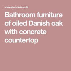 Bathroom furniture of oiled Danish oak with concrete countertop