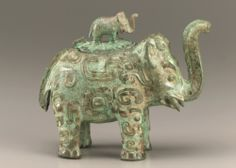 Lidded ritual ewer (huo) in the form of an elephant with masks and dragons  ca. first half 11th century B.C.E.    Shang dynasty   Late Anyang period    Bronze  Middle Yangzi Valley, China  Smithsonian Museums