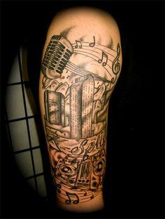 Denver skyline, music and microphone - black and grey tattoo sleeve - artist Trevor Sucato